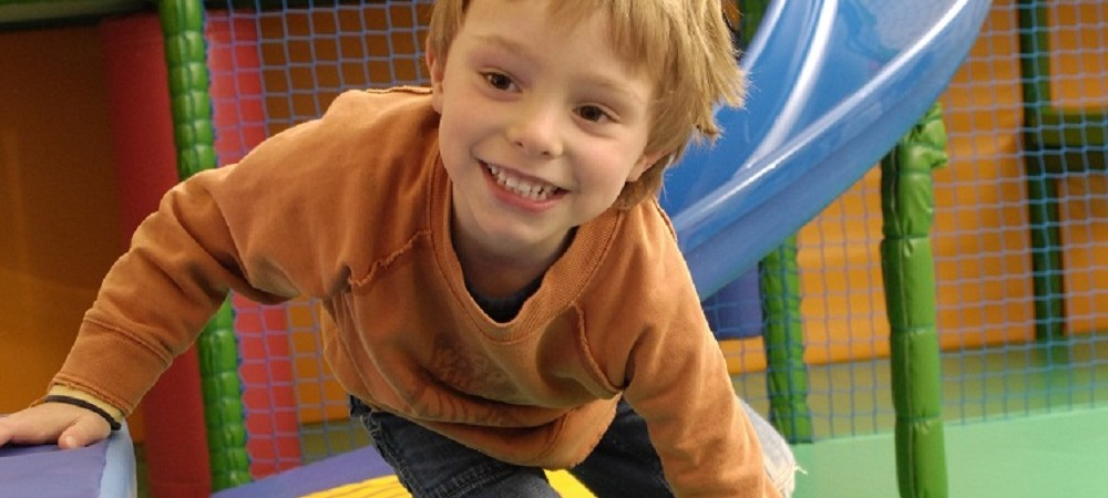 Tredethick Farm Cottages - toddler playing in playbarn