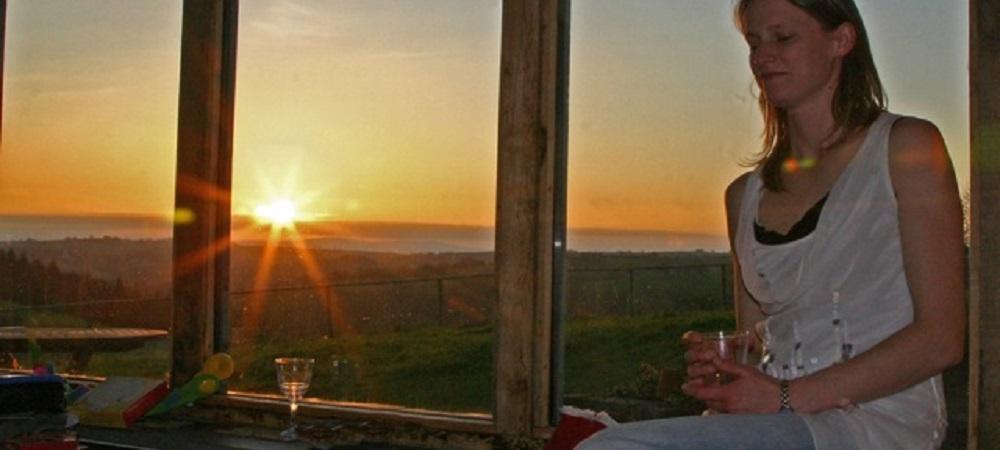 Ashridge Farm Holidays Devon - lounge view of Dartmoor at sunset